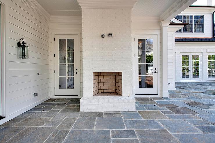 Covered-patio-white-brick-outdoor-fireplace-slate-floor